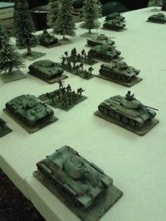 T34'S PRESS HOME THEIR ATTACK ON THE VILLAGE